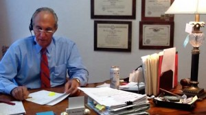 Glenn R. Roderman discussing a case with a client.